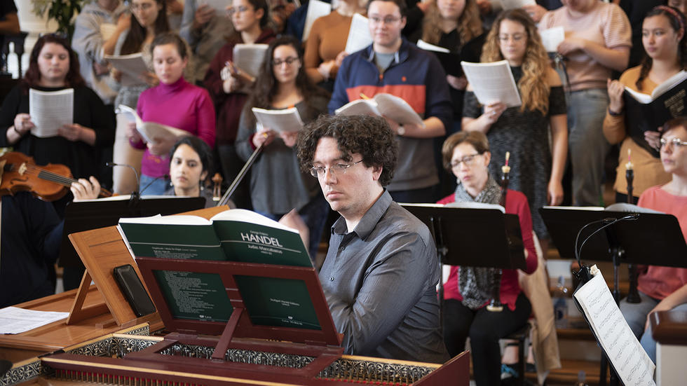 Thomas Sheehan plays the harpsichord in rehearsal Spring Concert