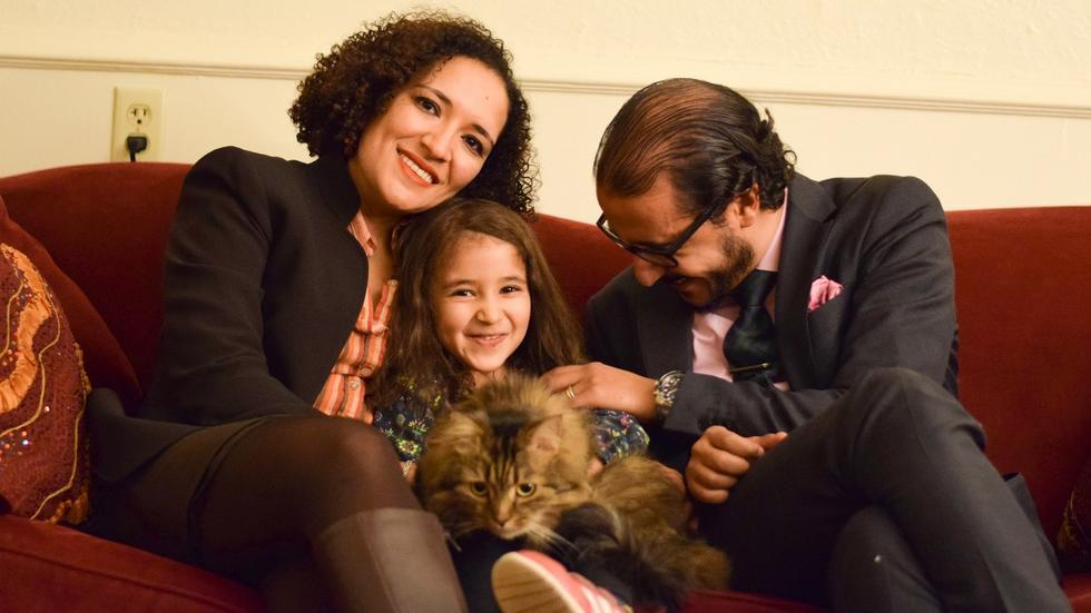 Professor Soha Bayoumi, their daughter Carmen holding their cat Jesse, and Professor Ahmed Ragab