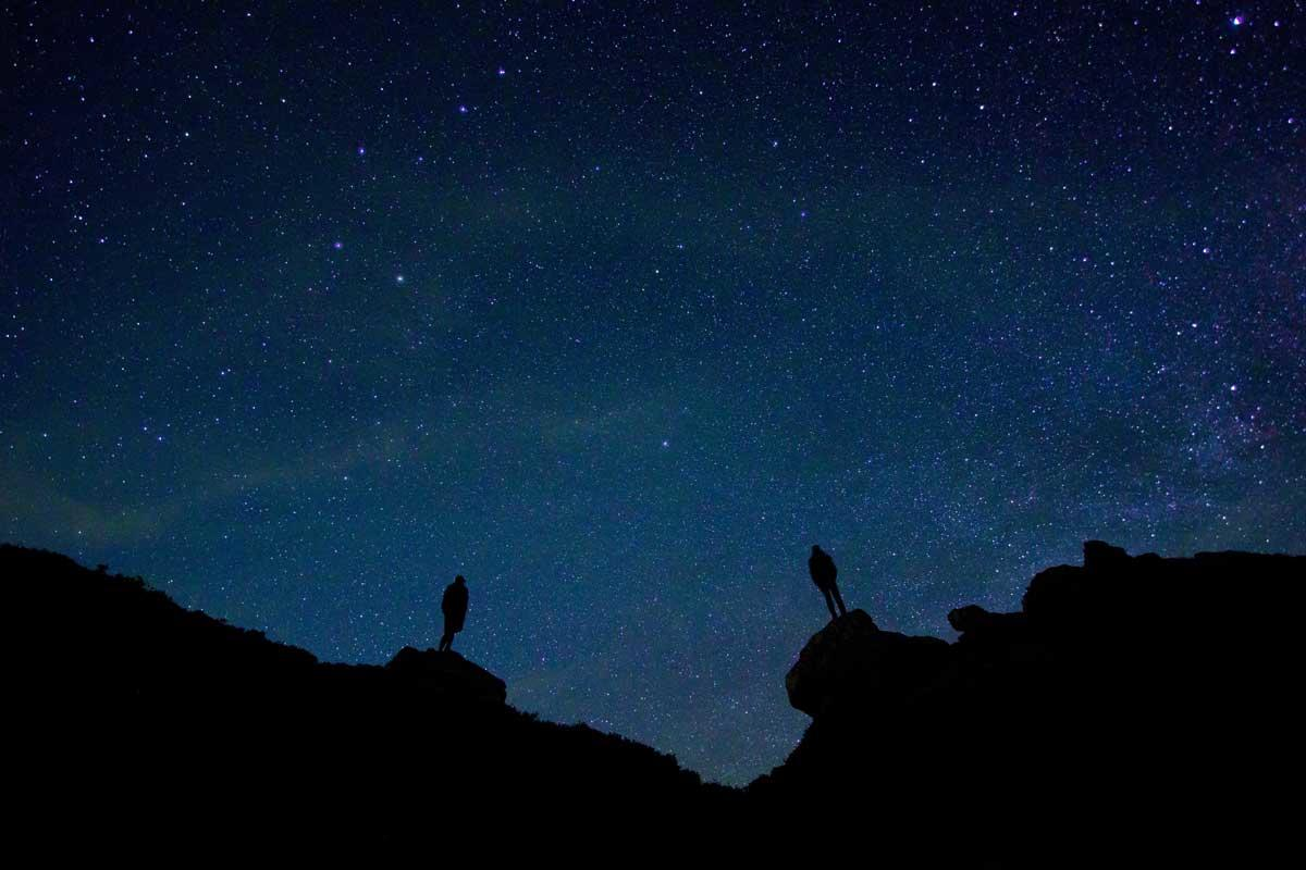 Image: two strangers against the night sky
