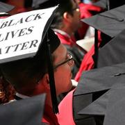 "A graduate student of Harvard Law School displays the message ""Black Lives Matter"" on his mortarboard during Harvard University commencement exercises, Thursday, May 28, 2015, in Cambridge, Massachusetts. (AP Photo  Steven Senne)"