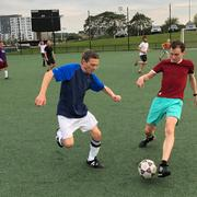 Avi Loeb and student playing soccer