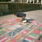 Image of man drawing flags on floor