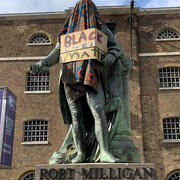 Robert Milligan Statue that has been draped and covered with a Black Lives Matter sign as protest