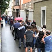 Line of voters extends down a street during the Catalan referendum