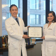 Dr. Chari receives her certificate.