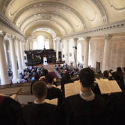 The University Choir sign from the loft of Memorial Church during Pal Sunday services.