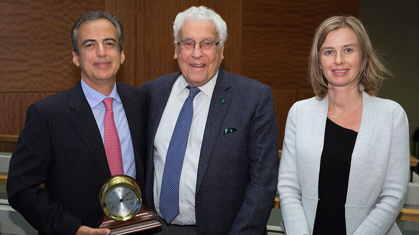 Co-directors Reza Dana, MD, MSc, MPH, and Ula Jurkunas, MD, present Claes H. Dohlman, MD, PhD with a commemorative clock