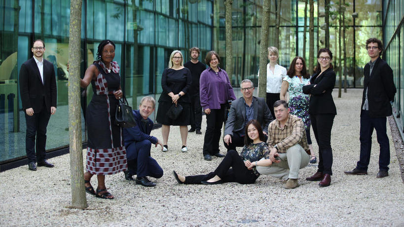 Photo of the artists, researchers and policy leaders responsible for Immune Nations art exhibition