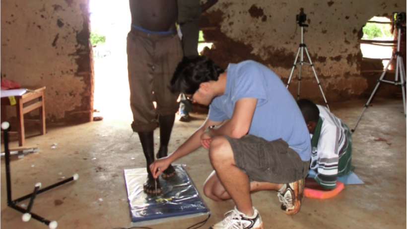 Graduate student Eric Castillo studying feet and backs during fielwork conducted in rural Kenya