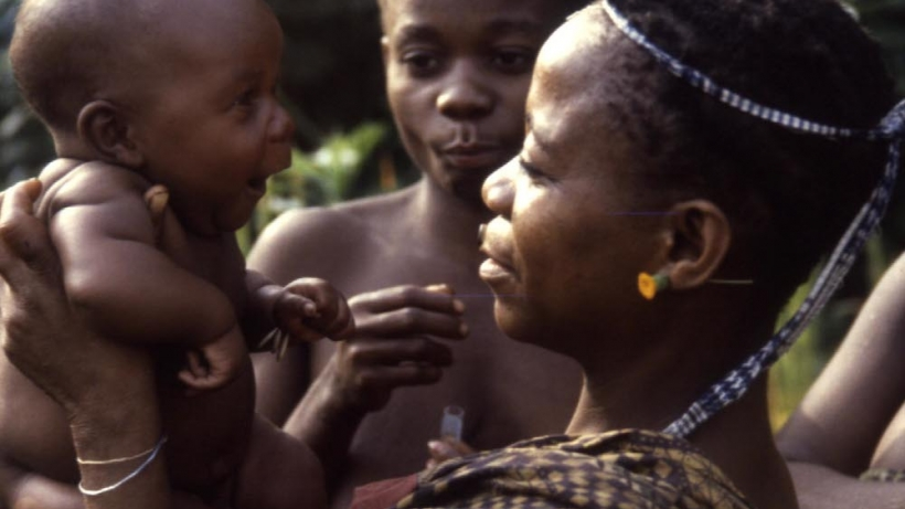 Efe women and child in the Ituri Forest of the Democratic Republic of the Congo