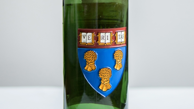 View of colored La Rose shield on green wine bottle