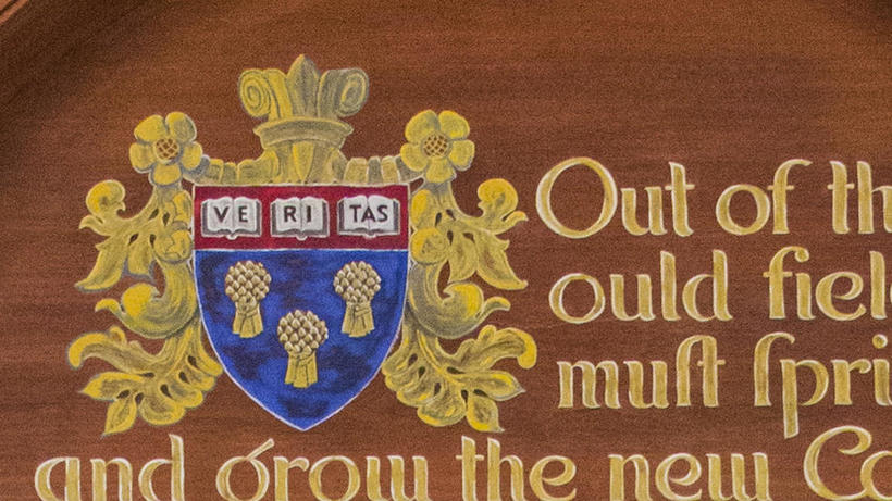 Color image of la Rose shield with three sheaves of wheat and part of quote by Coke
