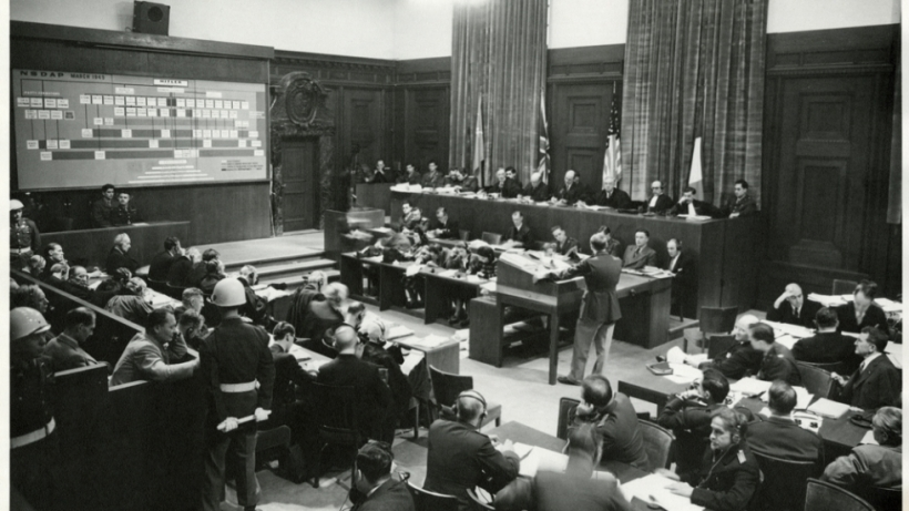 Court in session at the Nuremberg Trials. Major Frank B. Wallis addresses the court.