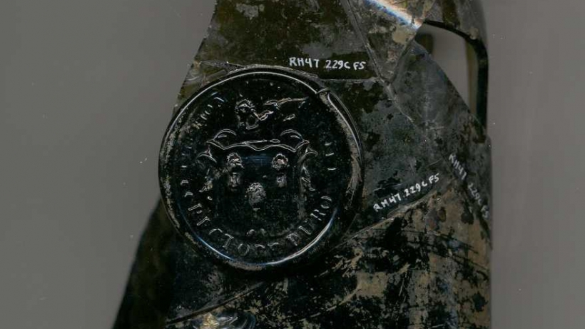 Detail of liquor bottle with Royall Family Crest