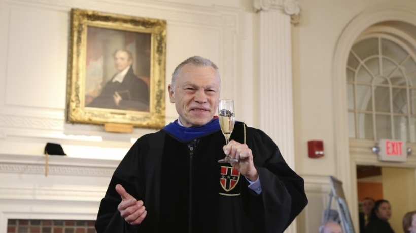 Photo of Tom Conley offering a toast to the senior class