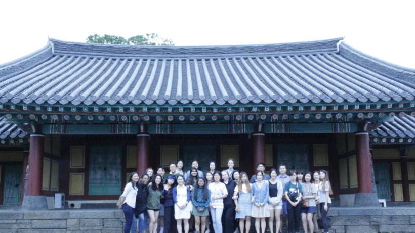 Photo of 2019 HSS Korea Program students posing in front of a traditional 'hanok' building in South Korea
