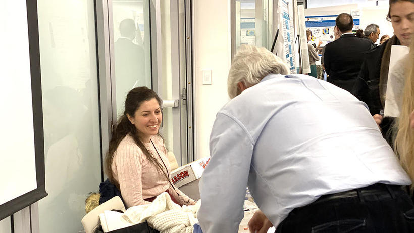 Science Education Research Advisor welcomes students at  table at HUROS 2019 fair