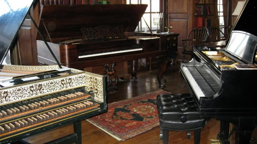 Harpsichord, square grand, and Steinway model B grand piano in Dunster House library
