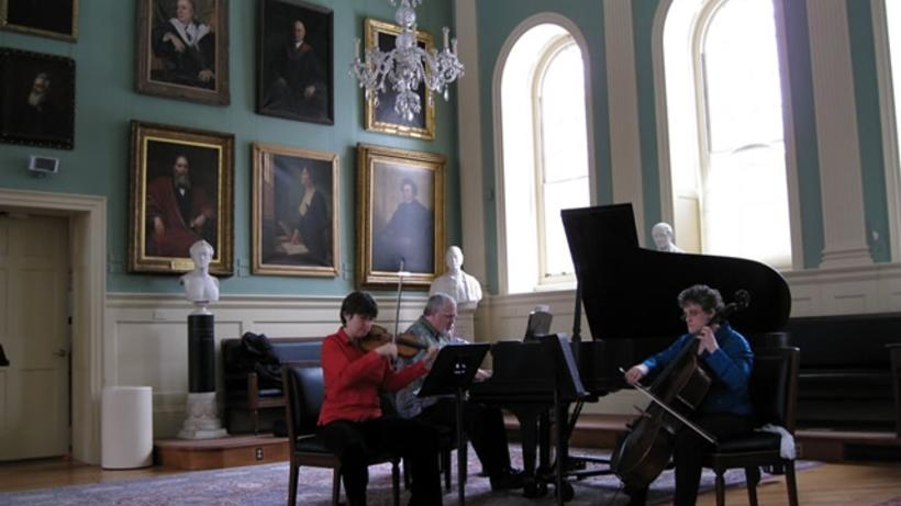 University Hall Noontime Recital Series in Faculty Room with piano, cello, and violin