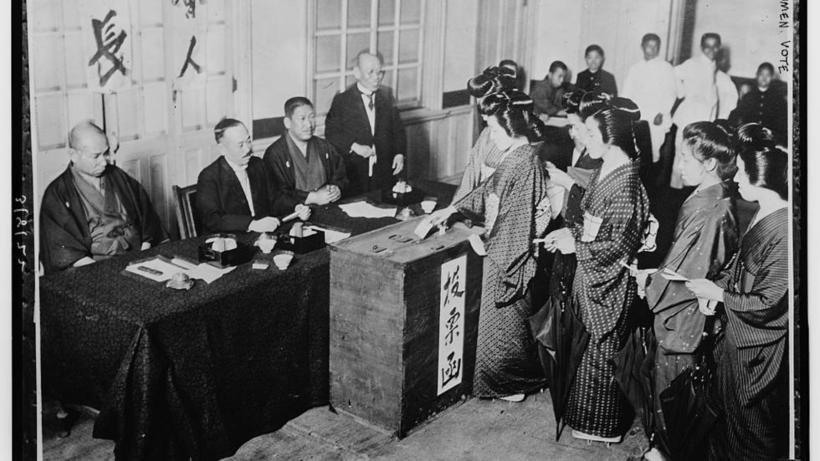 Japanese women lining up at the ballot to vote for perhaps the first time in Japanese history.