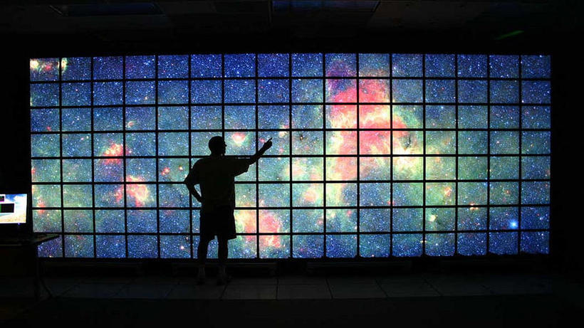 The center of the Milky Way galaxy imaged by NASA's Spitzer Space Telescope is displayed on a quarter-of-a-billion-pixel, high-definition 23-foot-wide (7-meter) LCD science visualization screen at NASA's Ames Research Center in Moffitt Field, CA.