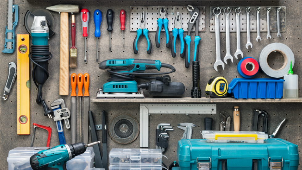 Set of tools displayed on work bench