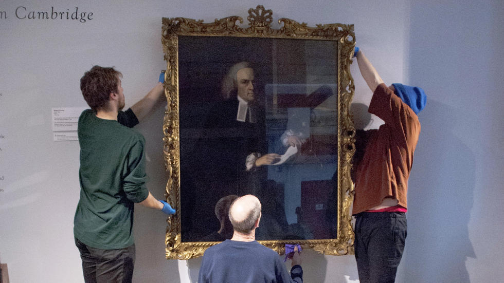 Portrait of John Winthrop by John Singleton Copley being temporarily installed in the Putnam Gallery.