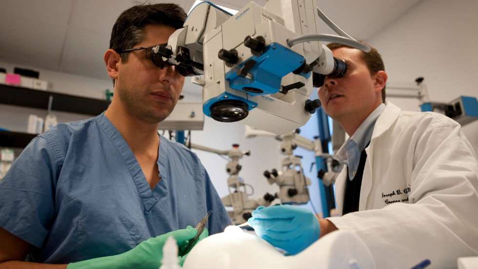 Dr. Joseph Ciolino with a trainee in the ophthalmology training laboratory