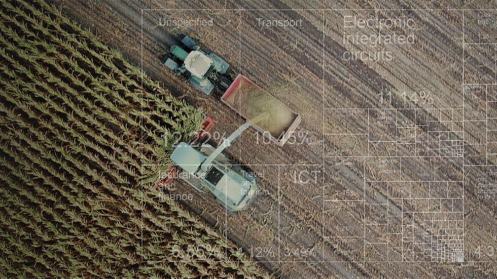 Two tractors plowing a field with a white tree map overlay