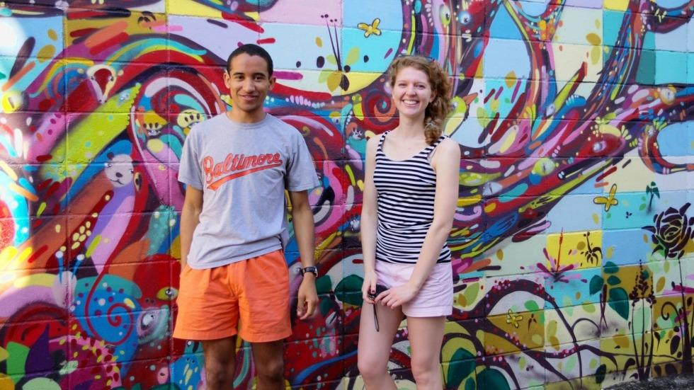 Mike and Ellie in front of a colorful wall