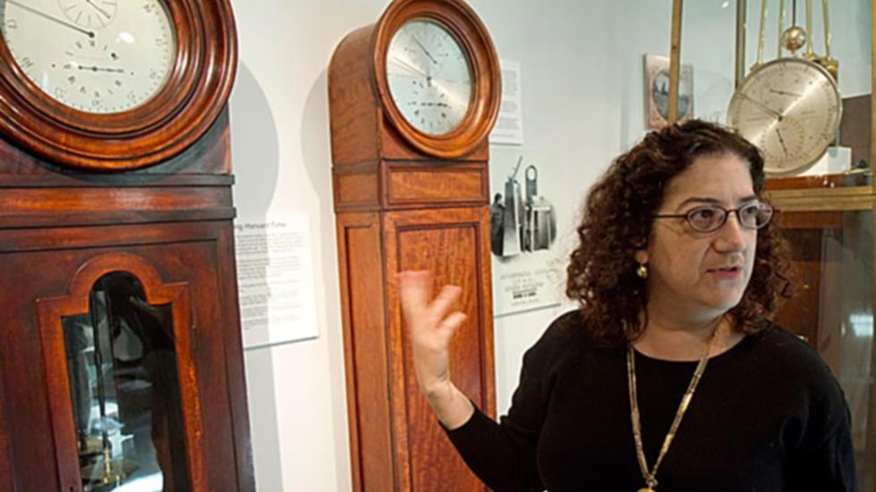Curator Sarah Schechner with Putnam Gallery timepieces