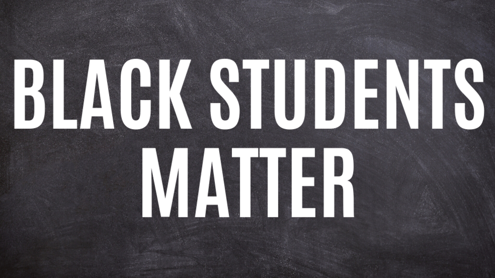 Background image of chalkboard with white text: Black Students Matter