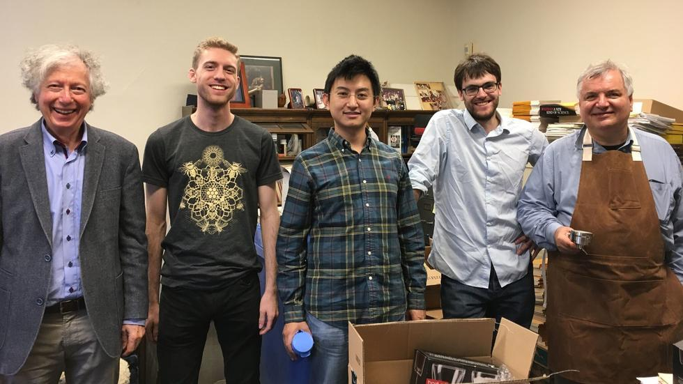 Arthur Jaffe, Chase Bednarz, Zhengwei Liu, William Norledge, and Adrian Ocneanu after unpacking the espresso machine.