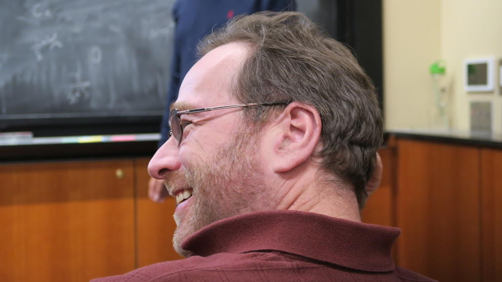 Pavel Etingof smiles in discussion at Zhengwei's seminar.