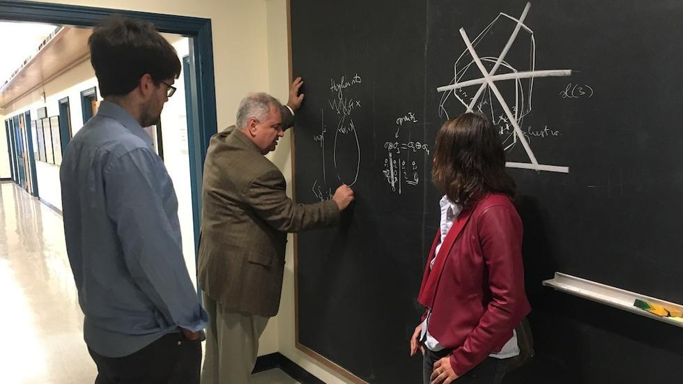 William Norledge, Adrian Ocneanu, and Alina Vdovina in discussion during her visit.