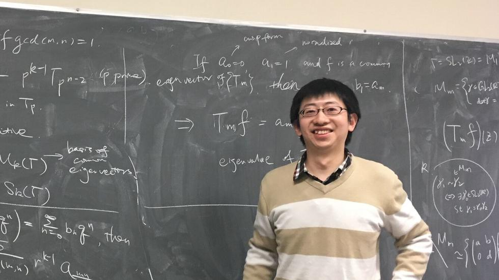 Boqing Xue gives a talk about number theory to group members.