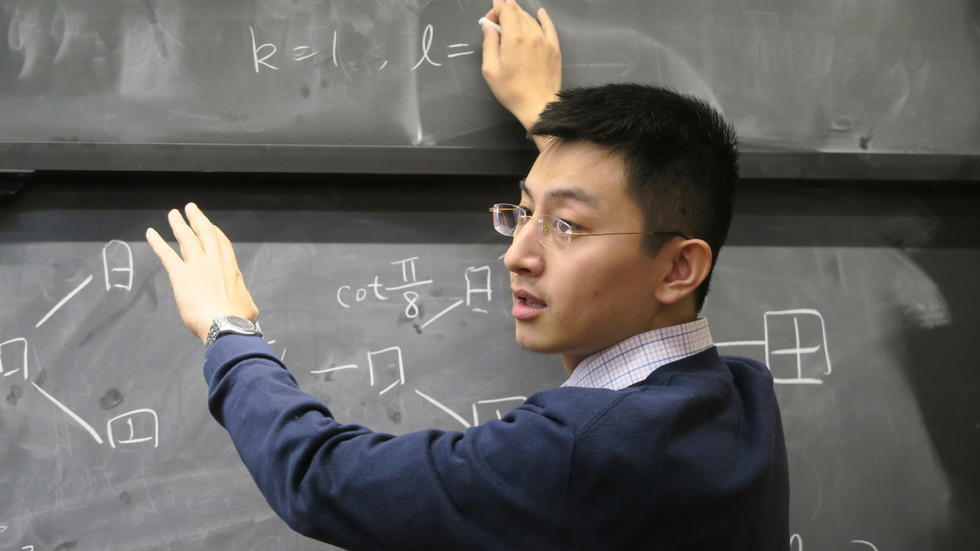 Zhengwei compares two Young's lattices at the board as he introduces his new centralizer algebra.