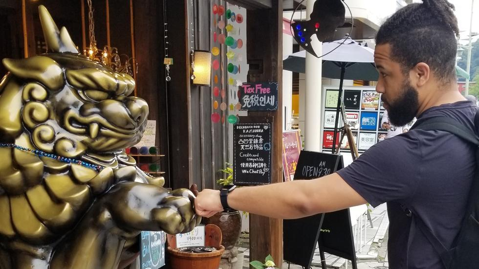 Jalem Towler_Summer in Japan_fist greeting guardian statue
