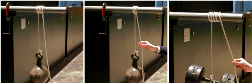 A 65-pound wrecking ball hangs by a rope that is wrapped around a metal pole.