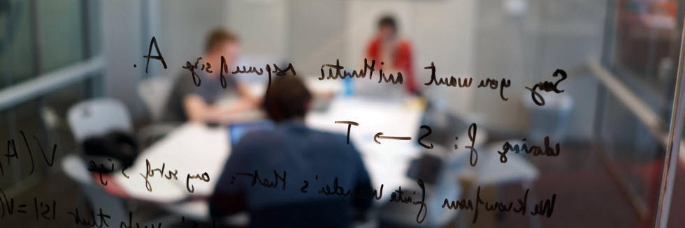 image of a group of students studying with a formula written on a glass wall