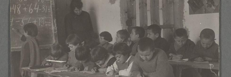 Photograph of refugee children, displaced by the Russian Revolution, in school room.