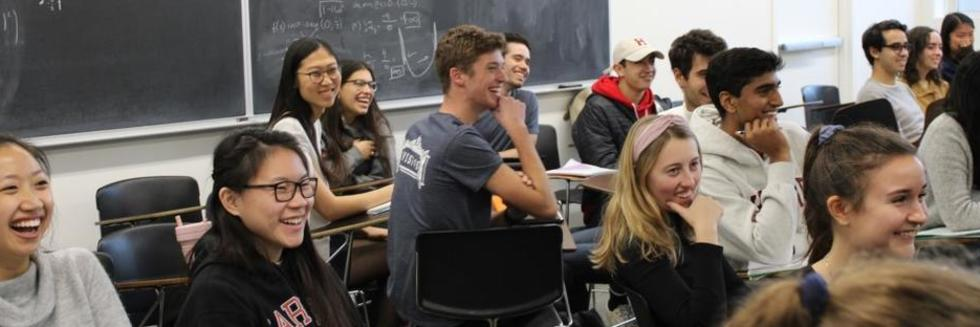 Students smiling in Gen Ed 1033. Photo credit: Claira Janover