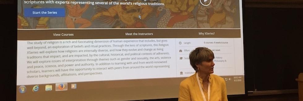 Diane Moore standing in front of screen showing World Religions website