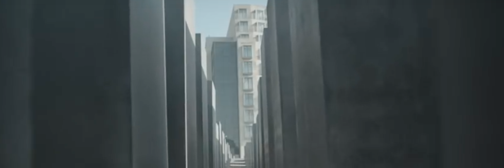 "View of rotated concrete stelae and the sloped grid of Peter Eisenman's ""Memorial to the Murdered Jews of Europe"" (Berlin, Germany; 2005) facing north toward Behrenstraße, filmed by Helen Han/Helen Han Creative (2015)"