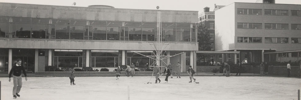View of Jarvis Field in winter set up as an ice skating rink. Harkness Commons in background.