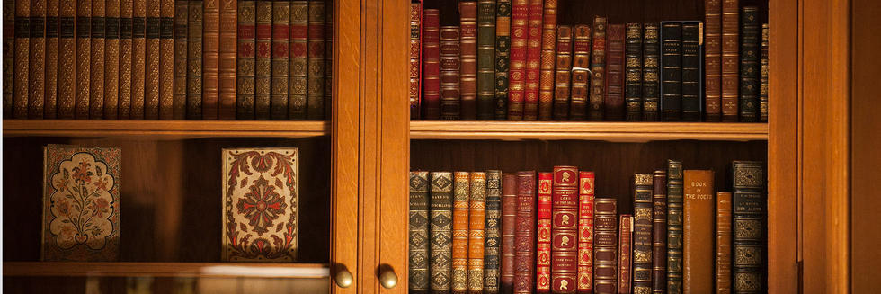 picture of books in a glass-fronted bookcase (Harvard)