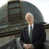 David Latham on roof of Observatory in front of old telescope dome.