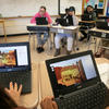 Kids playing Portrait of a Tyrant video game in class