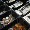 Image of an open cash register with money