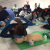 Nurse in training performs CPR on a dummy